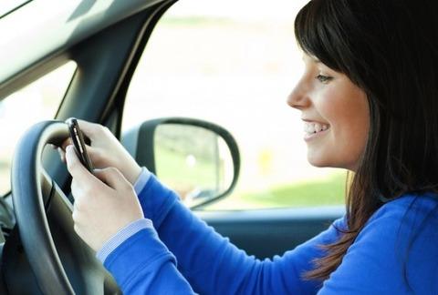 woman-texting-driving-shutterstock-572x386