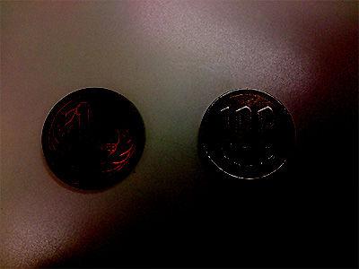ダークな輝きを持ったコイン