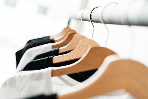 wooden-t-shirt-hangers-in-fashion-apparel-store-2-picjumbo-com