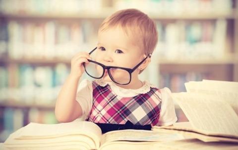 bigstock-Funny-Baby-Girl-In-Glasses-Rea-60092168-e1425033196236