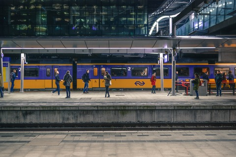 people-standing-near-train-under-shed-691471