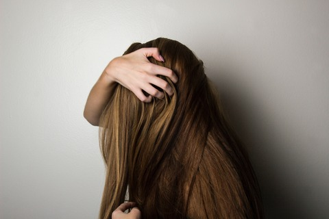 photo-of-woman-covering-face-with-her-hair-1159334