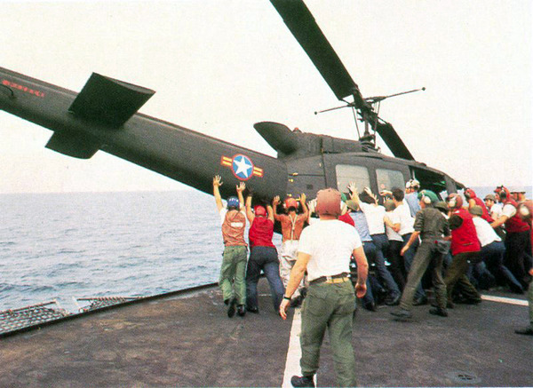 Vietnamese_UH-1_pushed_over_board,_Operation_Frequent_Wind
