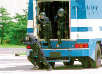 SAT_operators_deploying_from_heavily-armored_SWAT_Vehicle