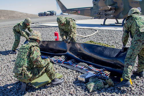 Japan_Defense_Force_members_prepare_ammo_for_Cobra