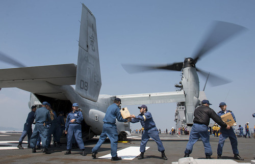 JMSDF_load_supplies_onto_an_MV-22B_Osprey_aircraft._