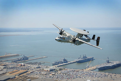 An_E-2D_Hawkeye_flies_over_Naval_Base_Norfolk_(13315193084)