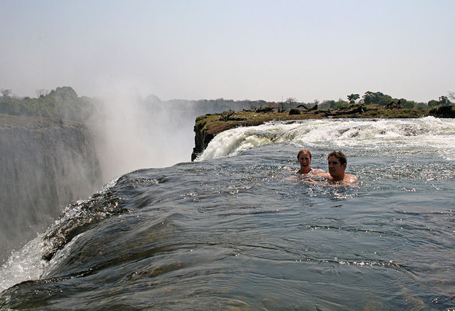 800px-Tourists_swimming_at_Victoria_Falls