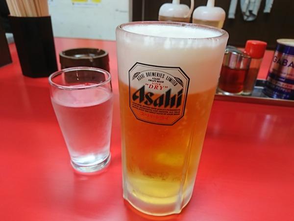 粋宏閣のとり肉とにんにくの芽炒めで生ビールを一杯
