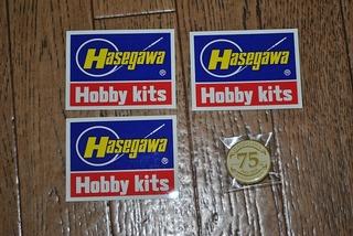 ST-HASEGAWA シールと缶バッジ