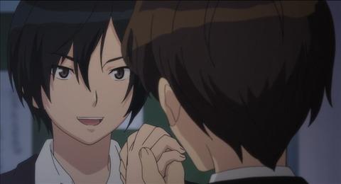 郁夫と握手する嘉味田