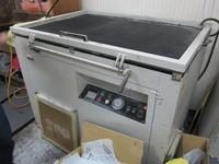 版にデザインを焼き付ける機械 (1)