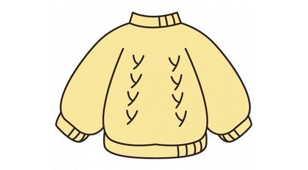 セーターが似合いすぎな犬の画像