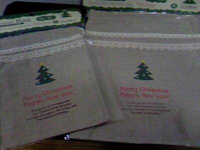 クリスマス柄の巾着 大・小