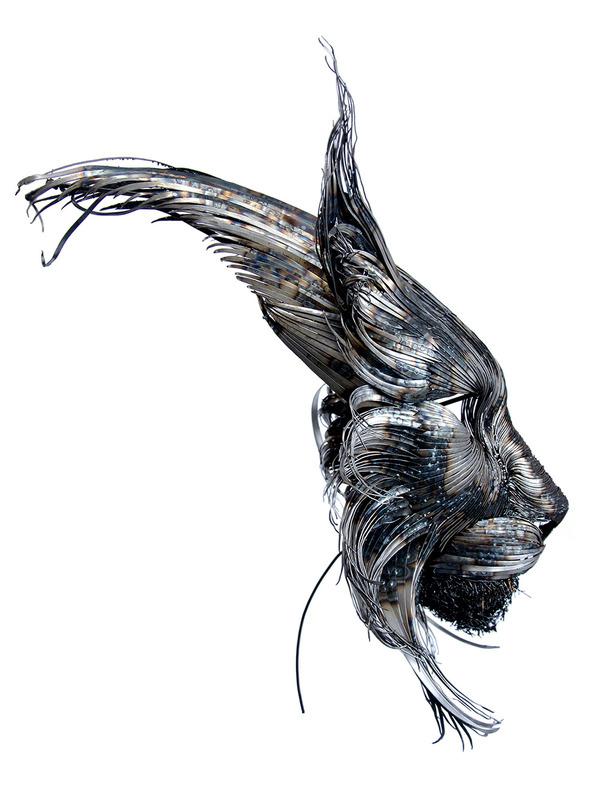 オオヤマネコの金属彫刻 2