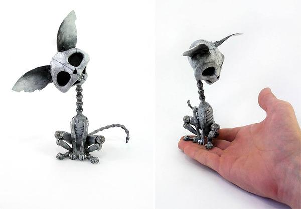 車や時計の部品から作られた動物の模型