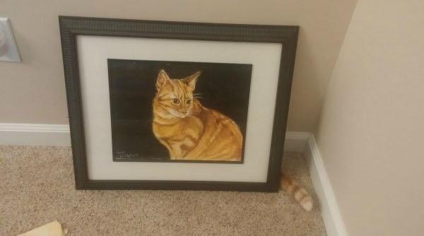 絵に隠れる猫