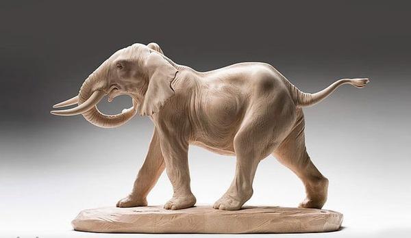 生き生きとした躍動感!野生動物の木彫りの彫刻作品 (13)