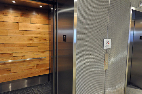 elevator_door_open_to_show_wood_paneling_1397225315
