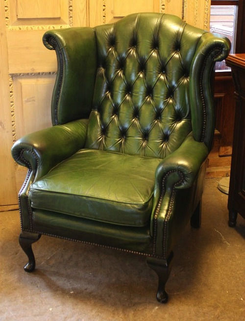 High back green leather wing chair
