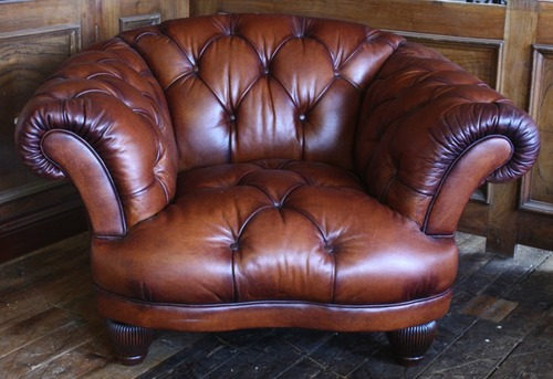 Vintage style brown leather Chesterfield armchair