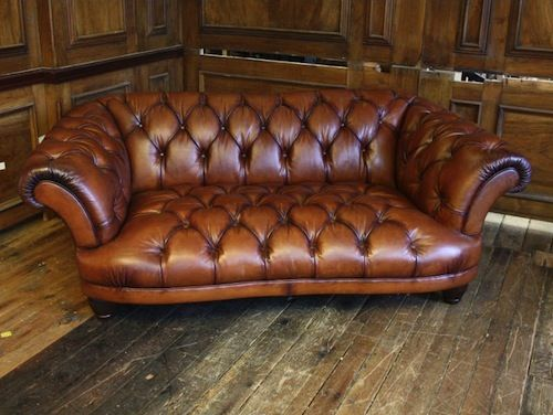 Vintage brown leather Chesterfield-style two seater sofa