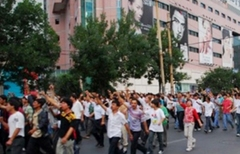 Demonstrators march in Urumqi, July 5, 2009