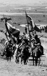 チベット国旗を掲げ中国との戦いに向かうチベット軍