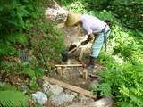 登山道整備する副組合長