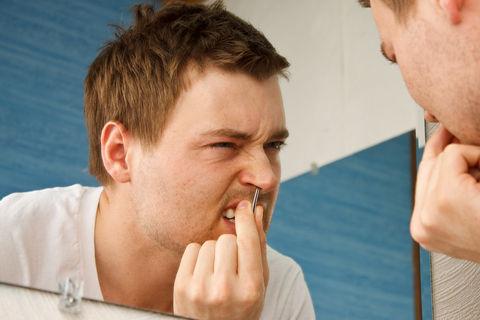 Man-Plucking-Nose-Hair