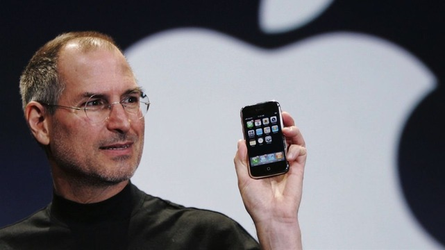 Steve_Paul_Jobs_and_his_Apple_iphone_1366x768