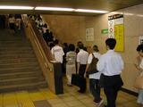 ある朝の駅階段風景