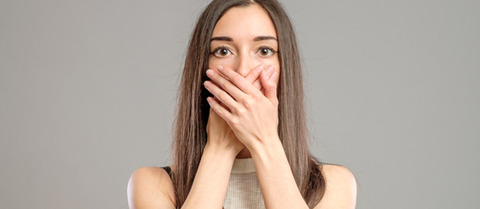 Woman-covering-the-mouth