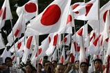 Protesters holding Japanese national flags