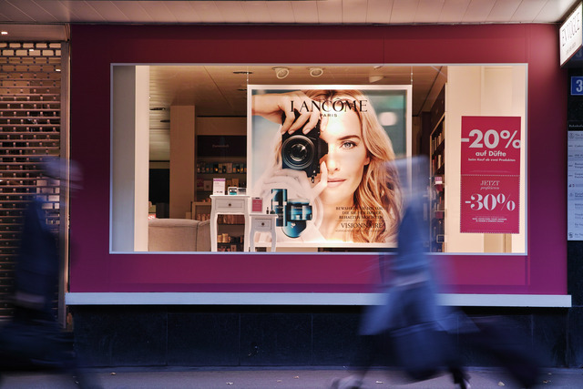 Photographer in the Store Window