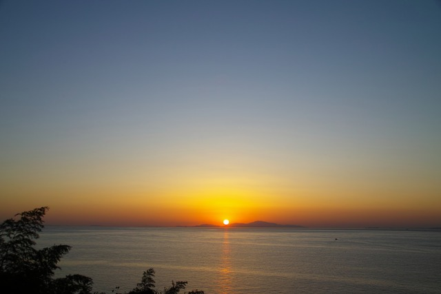 夕日とズームレンズ