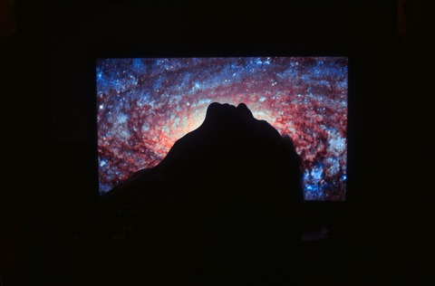 black-flat-screen-tv-turned-on-showing-blue-and-orange-3475378