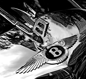 280px-Bentley_badge_and_hood_ornament-BW