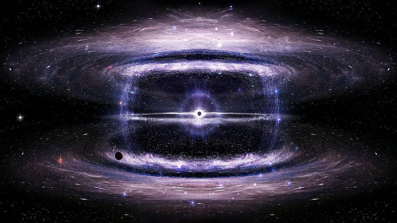 銀河の中心にある巨大なブラックホールが周囲にある大量の物質を飲み込み、放射圧により物質を吐き出す画像をご覧ください