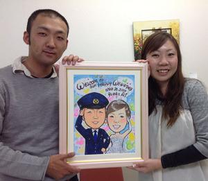 警察官の新郎さんと二人で敬礼、ディズニー風の似顔絵ウェルカムボード~奈良県のお客様