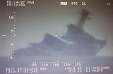 解放軍の攻撃を受け沈む駆逐艦「芦立」