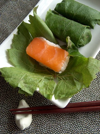 salmon sushi in vine leaves