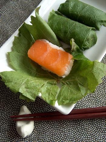 salmon sushi in vine leaves