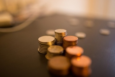 piles-of-coins-on-tables
