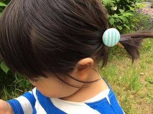 くるみボタン髪に結んだところ