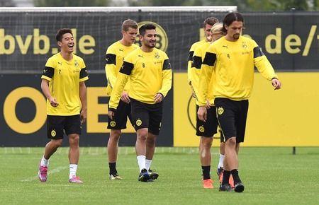 Dienstag 02.09.2014, 1. Bundesliga, Saison 2014/2015, Training BV Borussia Dortmund, Shinji KAGAWA (BVB), Lacht, rechts Ilkay GUENDOGAN (BVB), Sven BENDER (BVB), Neven SUBOTIC (BVB)  Foto: DeFodi.de +++ Copyright Vermerk DeFodi.de -- DeFodi Ltd. & Co. KG, Wellinghofer Str. 117, D- 44263 D o r t m u n d, sport@defodi.de, Tel 0231-700 500 44, Fax 0231-700 54 90, C o m m e r z b a n k  D o r t m u n d, Kto: 36 11 76 100, BLZ: 440 400 37 // BIC COBADEFFXXX // IBAN: DE74 4404 0037 0361 1761 00 // Steuer-Nr.: 315/5803/1864 , USt-IdNr.: DE814907547 - 7% MwSt.