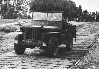 JEEP HEADED INLAND OVER STEEL MATTING NEAR LES ANDALOUSES