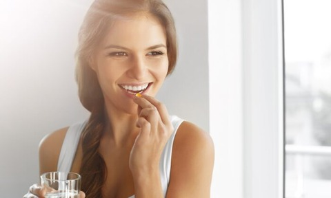 woman-takes-vitamin-d-capsule-700x420