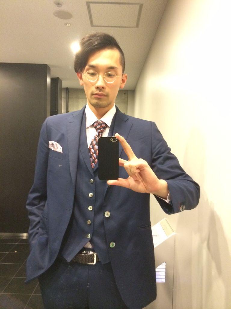スーツのジャケットをジャケ ...