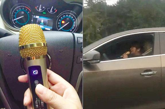 中国、女性が運転しながらマイクを持って歌う1